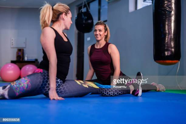 couple of females doing splits on pilates training - doing the splits stock photos and pictures