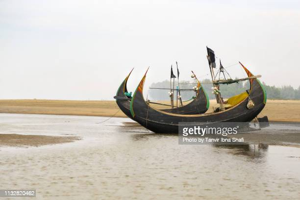 couple of fishing boats are docked at the cox's bazaar sea beach - bangladesh stock pictures, royalty-free photos & images