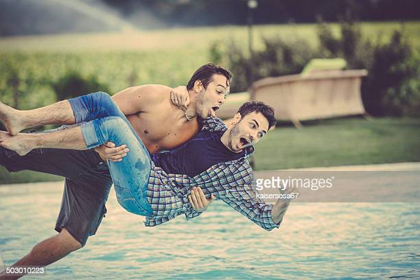 Couple of Friends having fun in a swimming pool