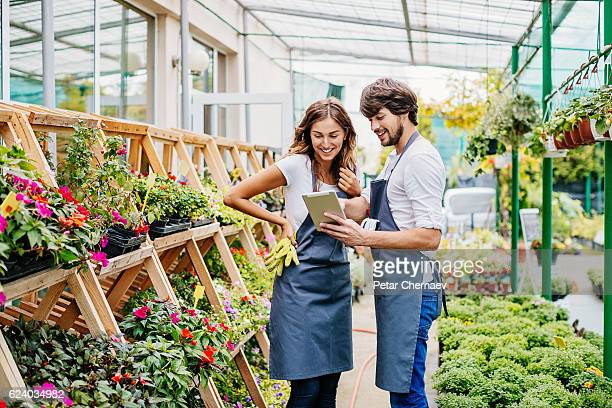 Couple of gardeners with digital tablet