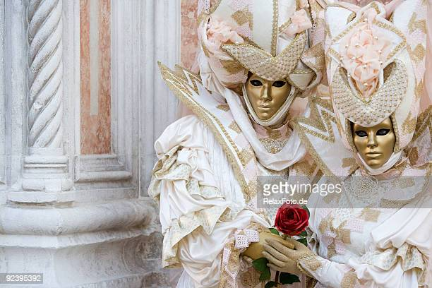 couple of golden venetian masks in beautiful creative costumes (xxl) - venice carnival stock pictures, royalty-free photos & images