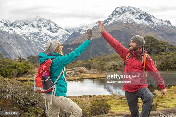 Couple of hikers celebrating on mountain top
