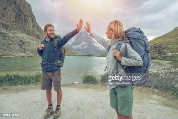 couple of hikers in zermatt, matterhorn view- switzerland - pinnacle peak stock pictures, royalty-free photos & images