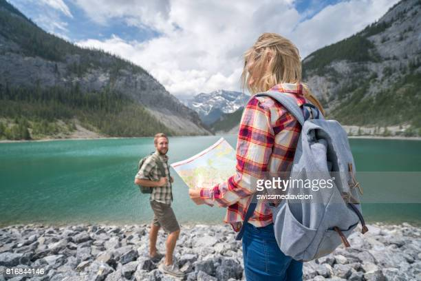 Couple of hikers looking at map