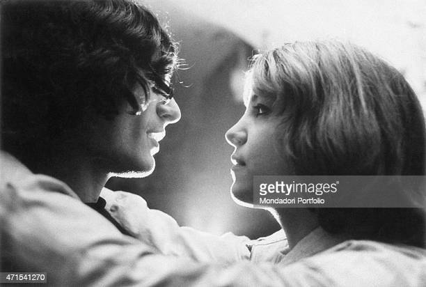 A couple of hippies belonging to the beatnik community hugging in a room of the club Mondo Beat the two young people look each other in the eye and...