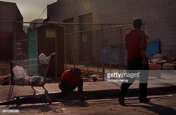 A couple of homeless men along 4th Street Friday afternoon in downtown LA The Los Angeles City Council voted unanimously Friday to make it illegal to...