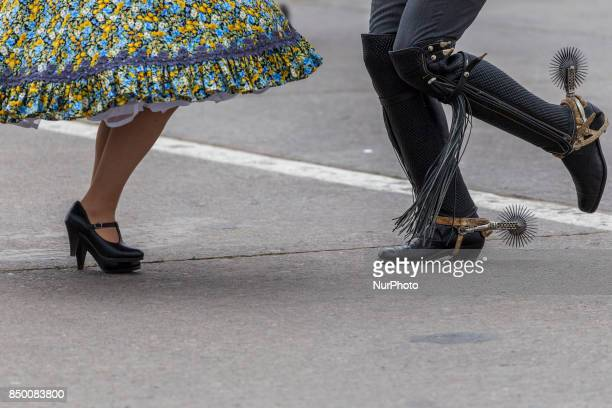 A couple of huasos of the club Gil Letelier dances cueca in front of the president and other authorities Chilean President Michelle Bachelet attends...