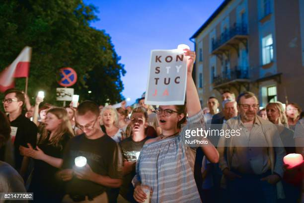 A couple of hundreds of antigovernment protesters gathered during a candlelit vigil in front of Rzeszow's District Court on Sunday evening in...