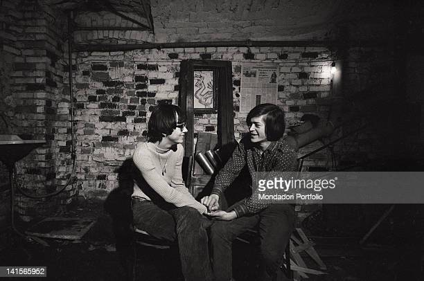 Couple of Italian beatniks holding hands at Mondo Beat club in Milan Milan 1960s