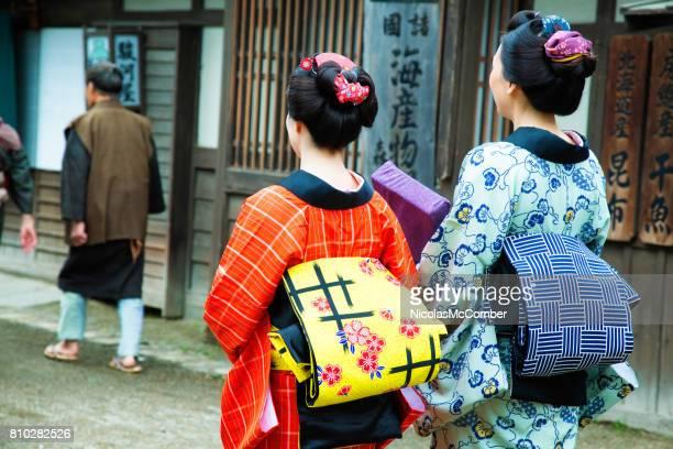 couple of japanese women in colorful kimonos with obi sash rear shot - obi sash stock pictures, royalty-free photos & images