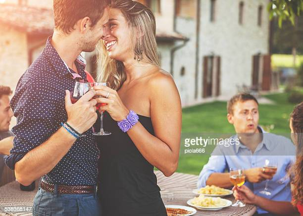 Couple of lovers kissing and drinking wine