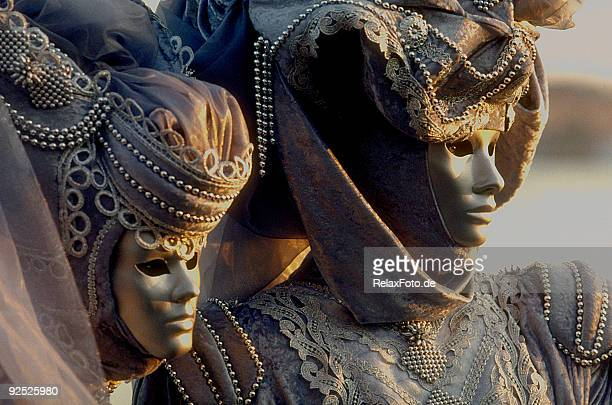 couple of masks with beautiful costumes at carnival in venice - venice carnival stock pictures, royalty-free photos & images