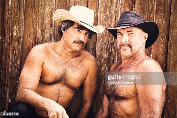 couple of mature hairy muscular gay cowboys - hairy chest stock photos and pictures