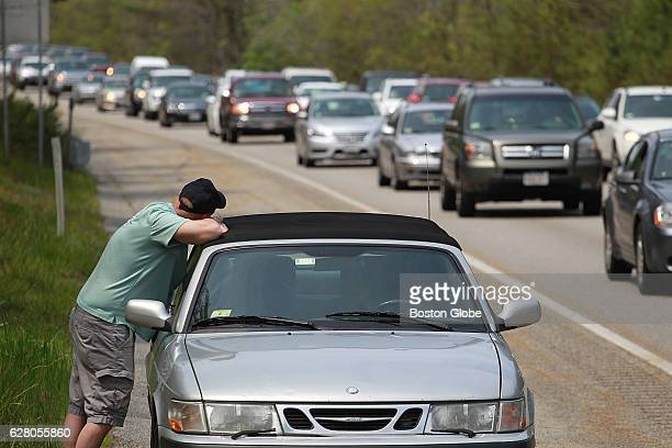 A couple of miles from the Sagamore Bridge in Bourne MA Daniel Reardon of Stoughton waits for roadside assistance after his car broke down on his way...