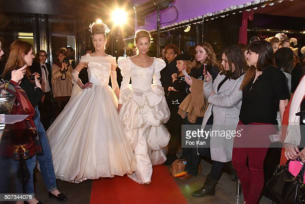 A 'couple' of models walk the Runway during the Jean Doucet 'Bonheur Pour Tous' Gay and Lesbian Wedding dresses show as part of Paris Fashion Week on...