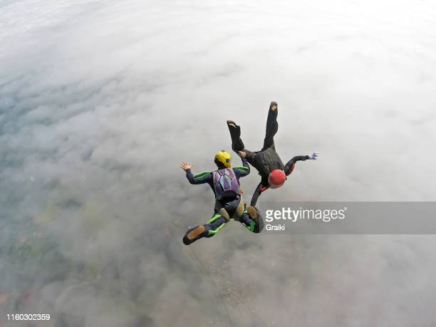 couple of parachutists jumping on a date. - sky diving stock pictures, royalty-free photos & images