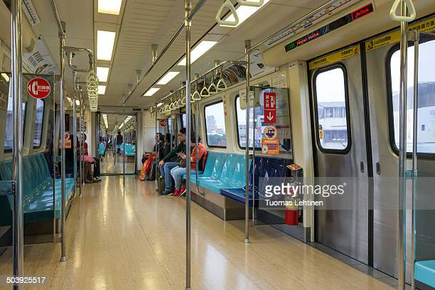 CONTENT] A couple of passengers inside a clean subway train in Taipei known as the Taipei Metro or MRT