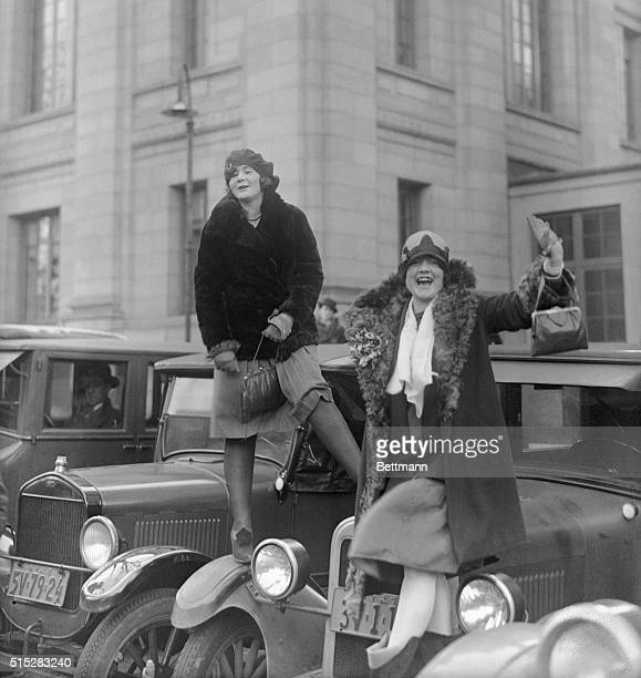 A couple of peaches crane their necks to get a look at Peaches Florence Banks and Helen Varina of White Plains New York climbed atop parked autos as...