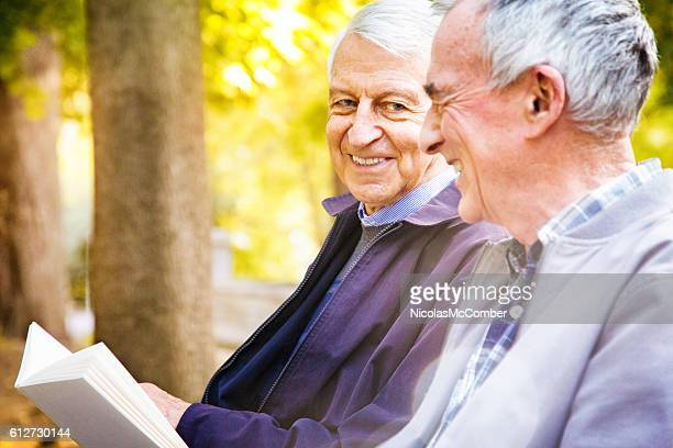 Couple of senior men sharing stories in park