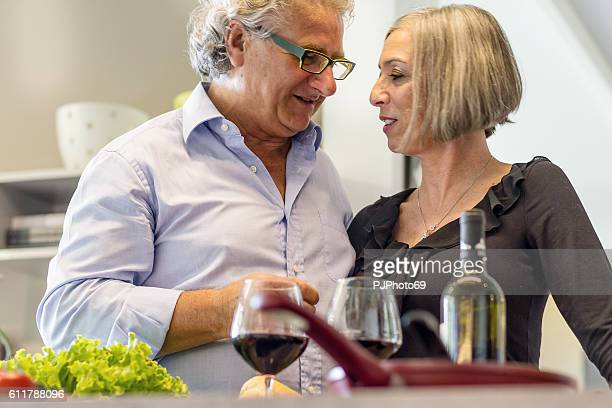 couple of seniors talking in the kitchen - pjphoto69 stock pictures, royalty-free photos & images