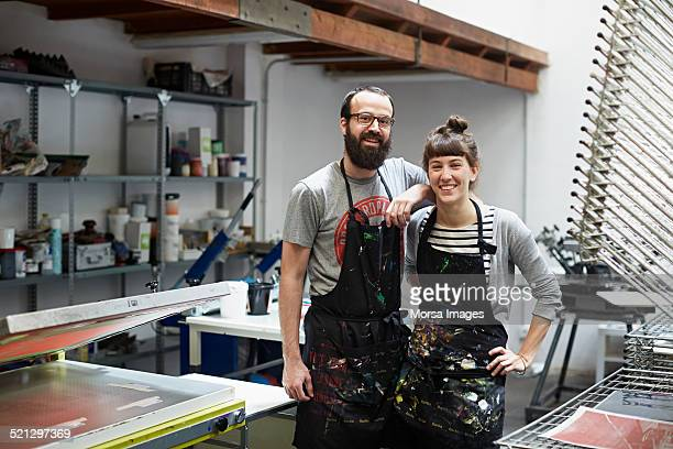couple of silk screen workers at their workshop - small business stock pictures, royalty-free photos & images