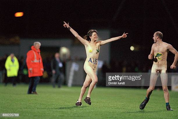 A couple of streakers invade the pitch during the Australia vs Romania game of the 1999 Rugby Union World Cup