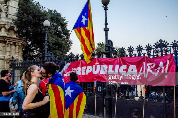 A couple of students are kissing while they await the results of the plenary of the Catalan Parliament Students were demonstrating in Plaza Sant...