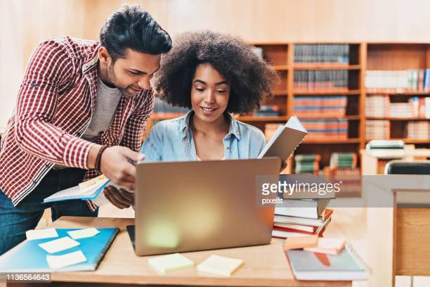 couple of students working together - community college stock pictures, royalty-free photos & images