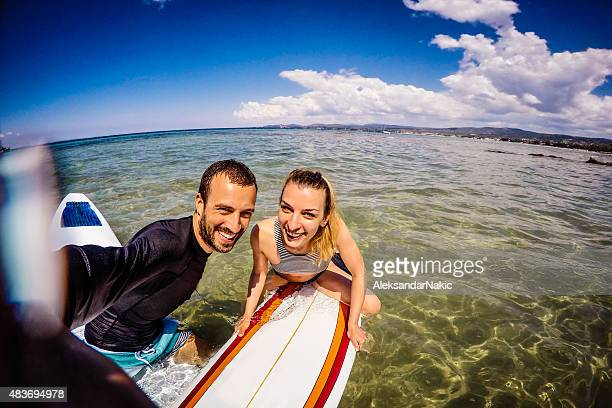Couple of surfers making a selfie