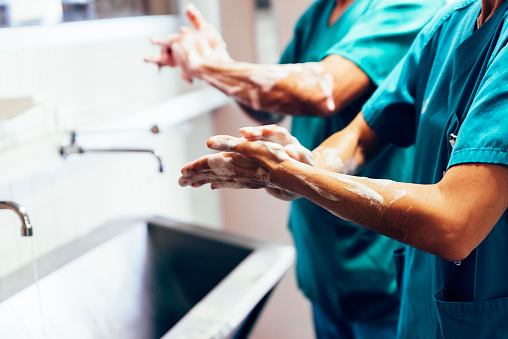 Couple of Surgeons Washing Hands Before Operating. 687758768