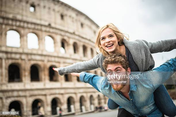 couple of tourist for st. valentine in rome - coliseum rome stock photos and pictures