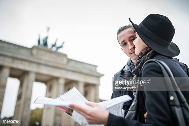 Couple of tourist in Berlin reading the tourist map