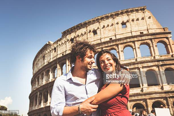 couple of tourist in rome - coliseum rome stock photos and pictures