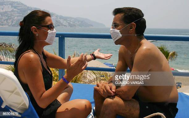 A couple of tourist talk wearing surgical mask to avoid contagion by the Influenza A in Acapulco Mexico on April 30 2009 The World Health...