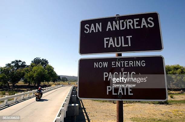 A couple of tourists arrive in Parkfield Ca Wednesday Sept 29 2004 Sign advising motorists they are crossing over the San Andreas Fault in Parkfield...