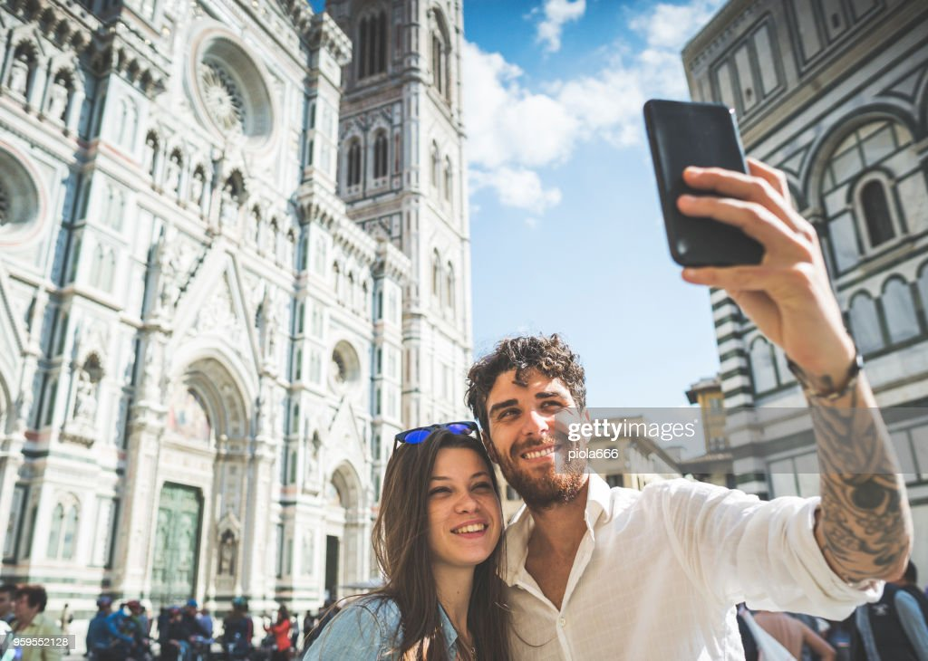 Couple of tourists in Florence, travelling around Italy : Stock Photo