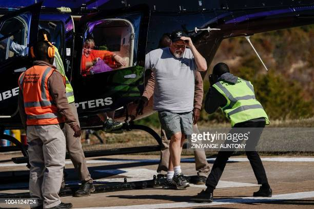 A couple of tourists Karen and Garry Brown from Tennessee US disembark from a tour flight of the Victoria falls on June 29 2108 in the resort town of...