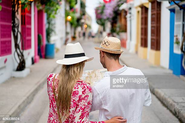 Couple of tourists looking at a map