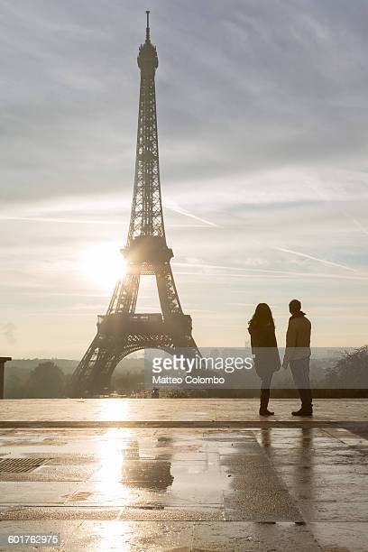 Couple of tourists looking at Eiffel tower, Paris