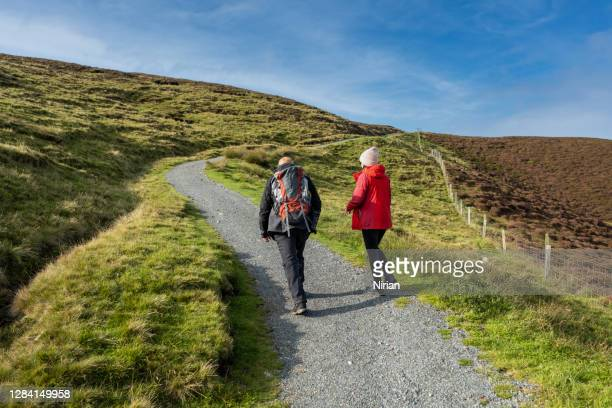couple of tourists on the trail - walking stock pictures, royalty-free photos & images