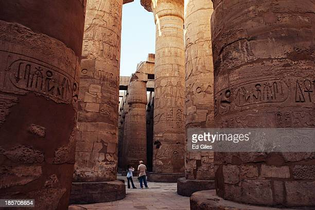 Couple of tourists walk through the Karnak Temple on October 22, 2013 in Luxor, Egypt. Karnak is the largest ancient religious site in the world,...