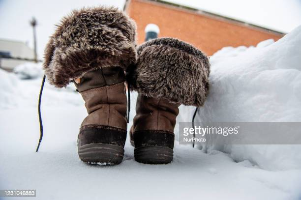 Couple of waterproof boots have been placed to point the high snow level, during the snowstorm Darcy in Nijmegen, on February 8th, 2021.