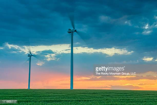 CONTENT] A couple of wind turbines photographed with a beautiful sunset and grassy plain part of the Cedar Point Wind Energy Project in Limon Colorado