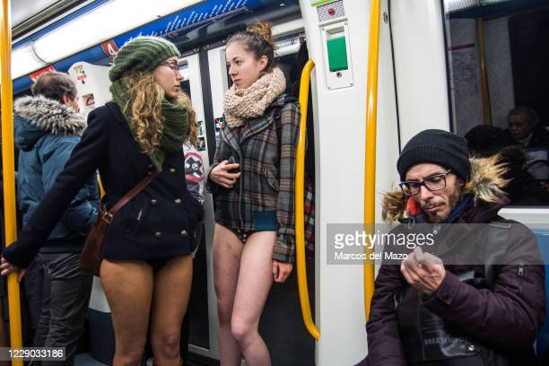 "Couple of women in underwear inside the metro during the annual ""No Pants Subway Ride""."