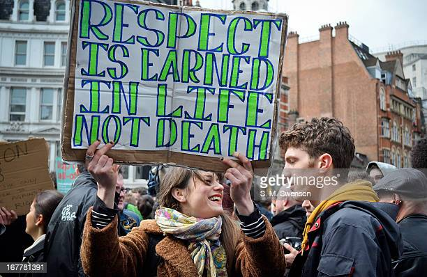 "Couple of young adult protesters at Margaret Thatcher's Funeral. The girl is holding up a placard reading, ""Respect is earned in life not death'. She..."