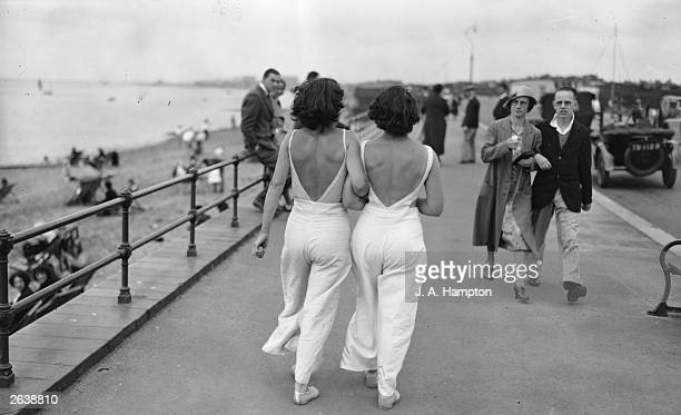A couple of young barebacked women strolling along the front at Thorpe Bay wearing matching beach pyjamas