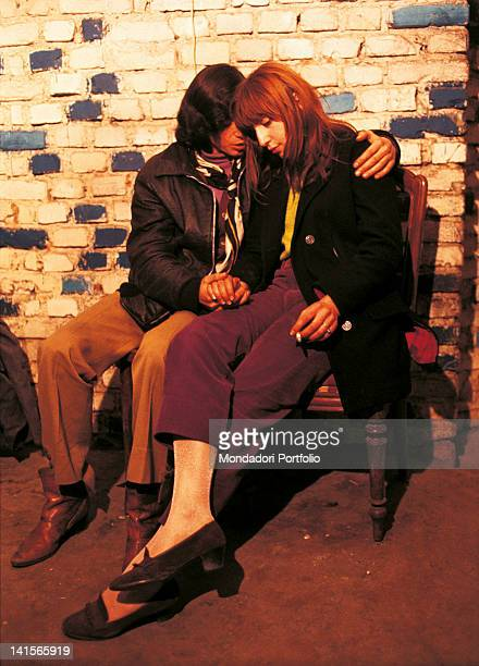 A couple of young Italian 'beatniks' hugging in the club 'Mondo Beat' Milan 1967