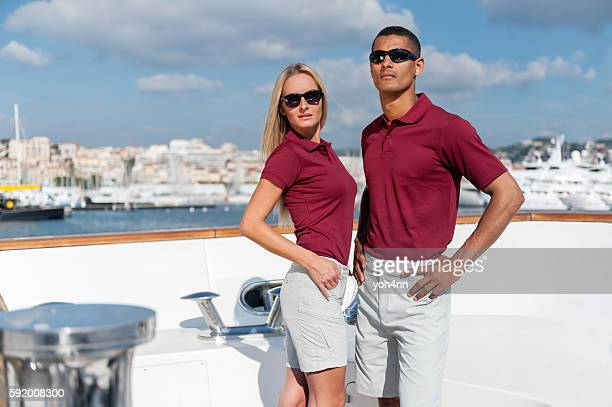 Couple of young models on luxury yacht