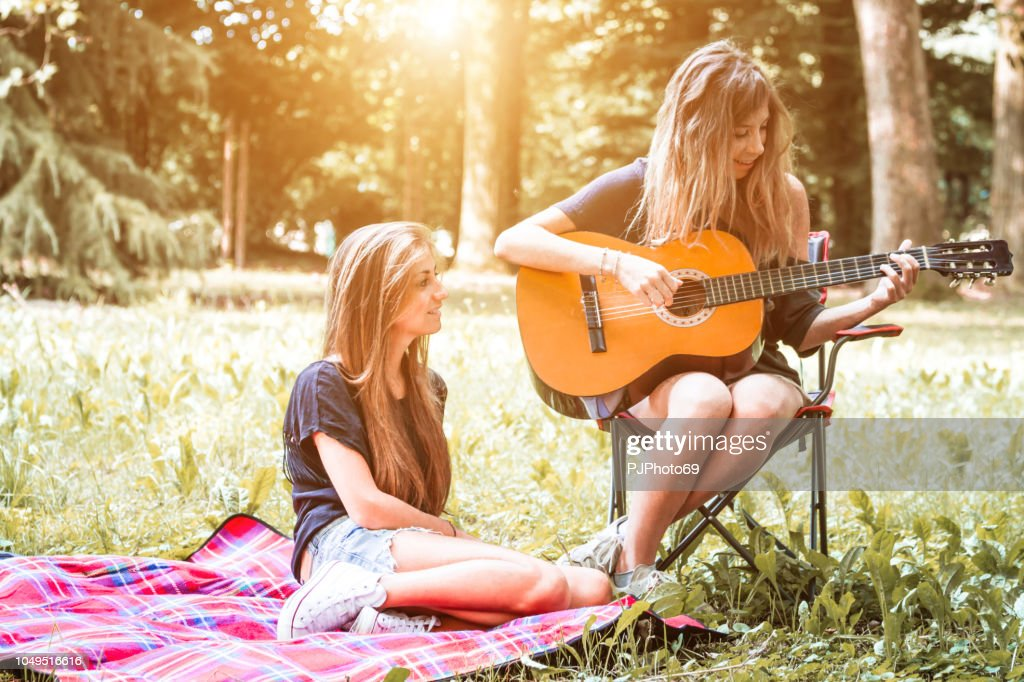 Couple of young women having relaxing time at camping : Foto stock
