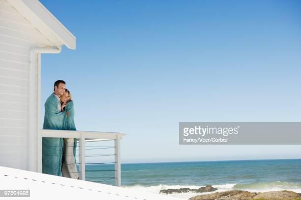 Couple on a beach house deck